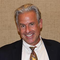 Hughes, Kirk T.
